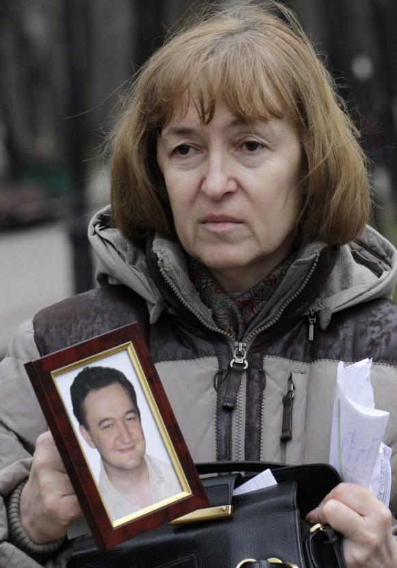 Nataliya Magnitskaya, mother of lawyer Sergei Magnitsky, holds a photo of her son in Moscow on Nov. 30, 2009. Magnitsky died in prison after accusing government officials of tax fraud to the tune of $230 million. (AP Photo/Alexander Zemlianichenko)