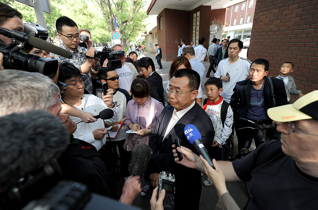 Foreign journalists interview Chinese rights lawyer Jiang Tianyong at a gate of the Chaoyang hospital in Beijing, where blind activist Chen Guangcheng is believed to be getting a check up, in Beijing on May 2, 2012. (MARK RALSTON/AFP/GettyImages)