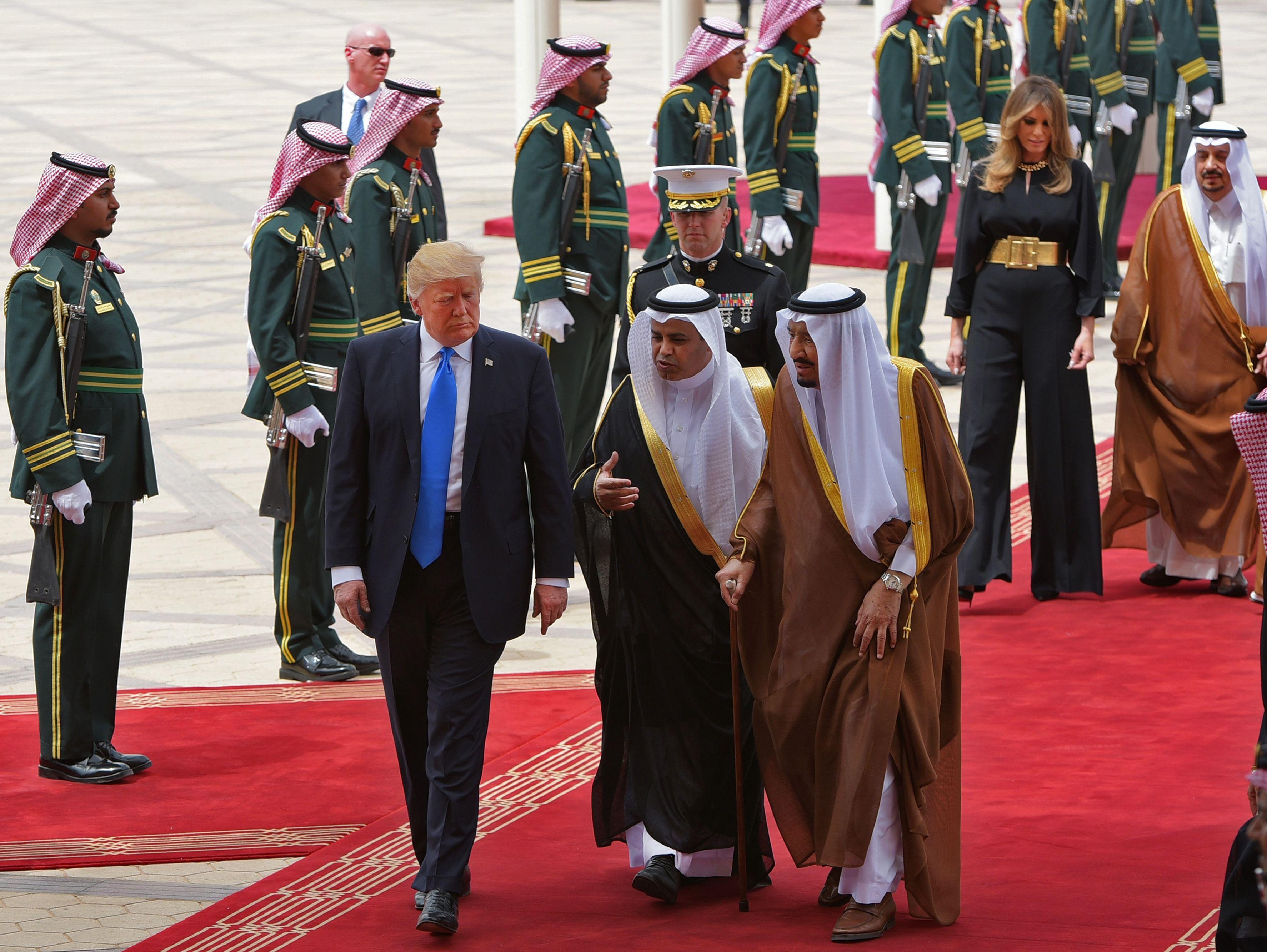 President Donald Trump is welcomed by Saudi King Salman bin Abdulaziz al-Saud (3rd R) upon arrival at King Khalid International Airport in Riyadh on May 20, 2017, followed by First Lady Melania Trump.  (MANDEL NGAN/AFP/Getty Images)