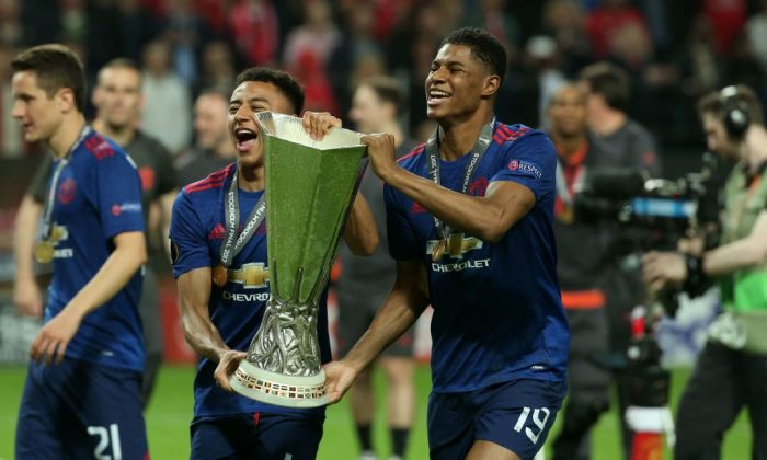 Manchester United's English striker Marcus Rashford (R) and Manchester United's English midfielder Jesse Lingard (2nd L) celebrate with the trophy after their team won the UEFA Europa League final football match Ajax Amsterdam v Manchester United on May 24, 2017 at the Friends Arena in Solna outside Stockholm. (Soren Andersson/AFP/Getty Images)