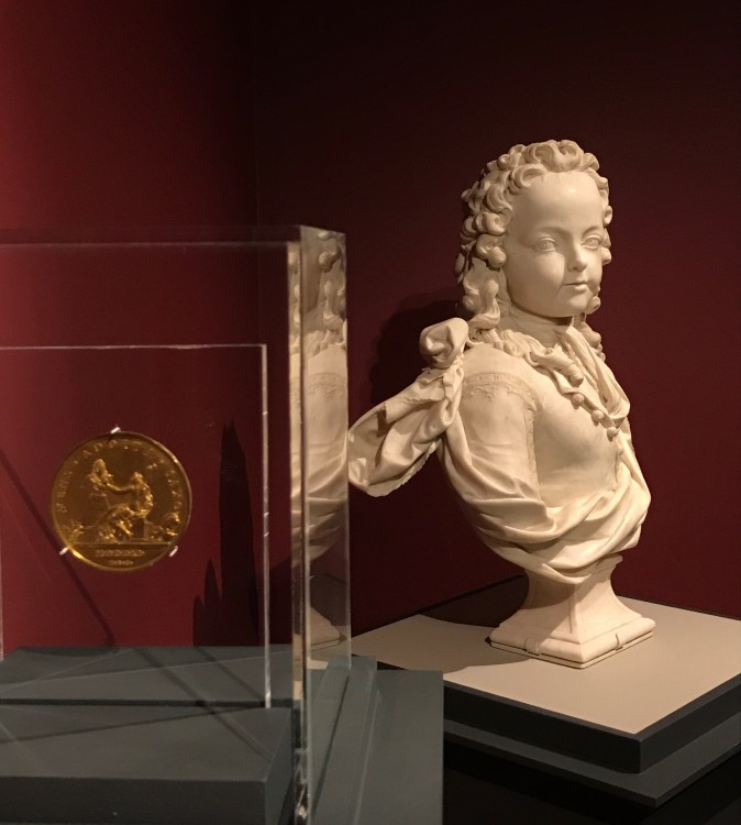 Antoine Coysevox (1640–1720), dated 1711, by Thomas Bernard (1650–1713). Gilt copper alloy, struck. Scher Collection, promised gift to The Frick Collection, and Louis XV as a Child of Six, 1716, by Antoine Coysevox (1640–1720). Marble, The Frick Collection, gift of Dr. and Mrs. Ira H. Kaufman, 1990. (Milene Fernandez/Epoch Times)