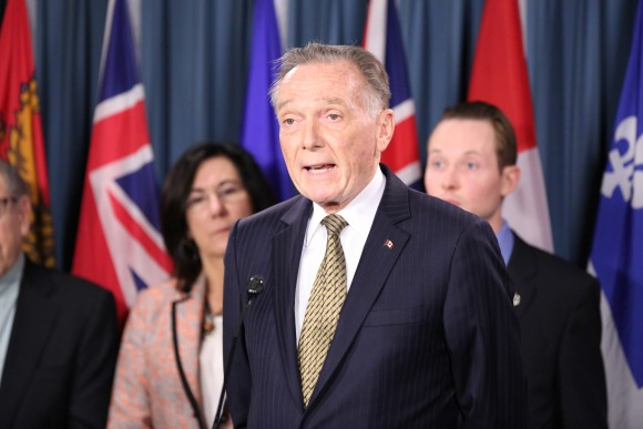 MP Peter Kent speaks at a press conference in support of efforts to secure the release of Canadian citizen Qian Sun detained in China for her practice of Falun Gong, on Parliament Hill in Ottawa on May 9, 2017. (Jonathan Ren/NTD Television)