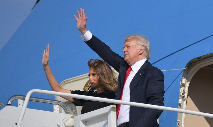 President Donald Trump and First Lady Melania Trump board Air Force One before departing from U.S. military Naval Air Station Sigonella following a G7 summit of Heads of State and Government, on May 27, 2017 near Taormina in Sicily. (Mandel Ngan/AFP/Getty Images)