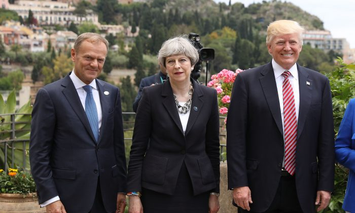 TAORMINA, ITALY - MAY 26:  G7 leaders European Council President Donald Tusk, British Prime Minister Theresa May and U.S. President Donald Trump attend a flypast at San Domenico Palace Hotel on May 26, 2017 in Taormina , Italy. US President Donald Trump and British Prime Minister Theresa May attend a G7 summit for the first time since their elections.  Also new to the table is French President Emmanuel Macron. China have been invited to a meeting during the summit for the first time.  (Photo by Dan Kitwood/Getty Images)