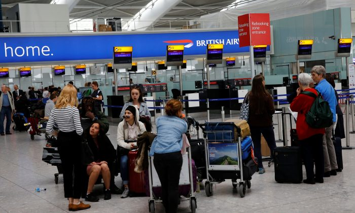 People wait with their luggage at a rebooking zone at Heathrow Terminal 5 in London, Britain on May 29, 2017. (REUTERS/Stefan Wermuth)