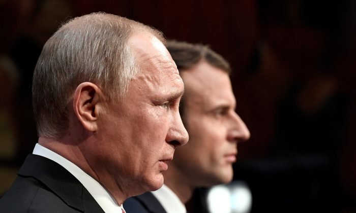 French President Emmanuel Macron (R) and Russian President Vladimir Putin (L) give a joint press conference at the Chateau de Versailles before the opening of an exhibition marking 300 years of diplomatic ties between the two countries in Versailles, France on May 29, 2017.   (REUTERS/Stephane De Sakutin/Pool)