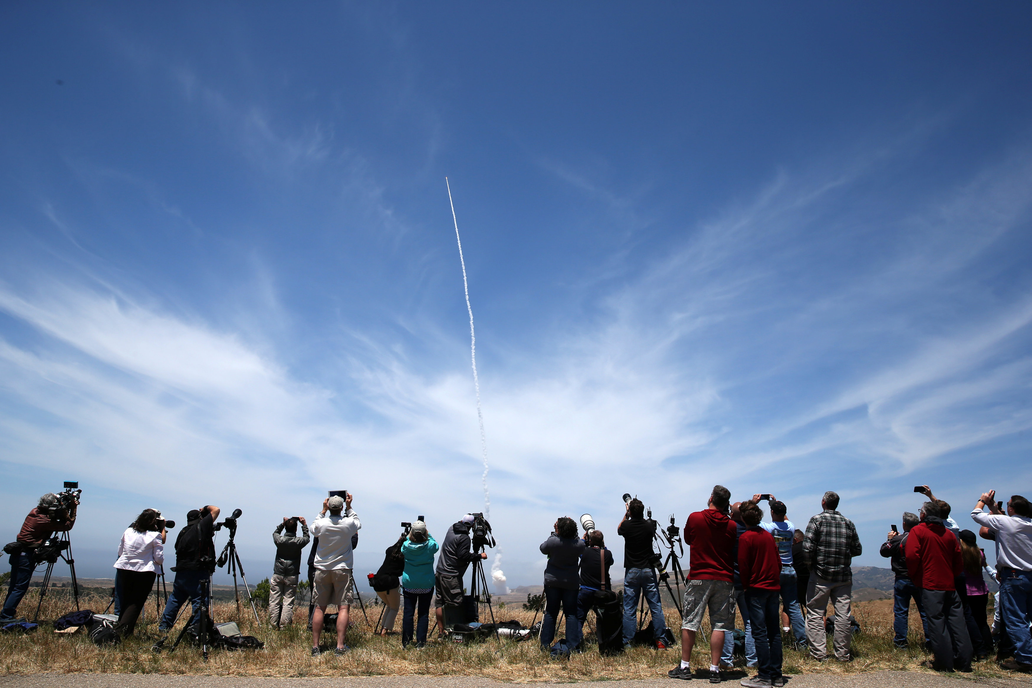People watch as the Ground-based Midcourse Defense (GMD) element of the U.S. ballistic missile defense system launches during a flight test from Vandenberg Air Force Base, Calif., on May 30, 2017. (REUTERS/Lucy Nicholson)
