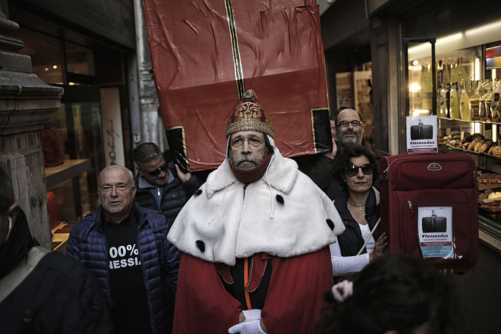 "A man wearing clothes of ""Doge"", the ancient governor of Venice, takes part in a demonstration against the increasing number of tourists in Venice on Nov. 12, 2016. (MARCO BERTORELLO/AFP/Getty Images)"