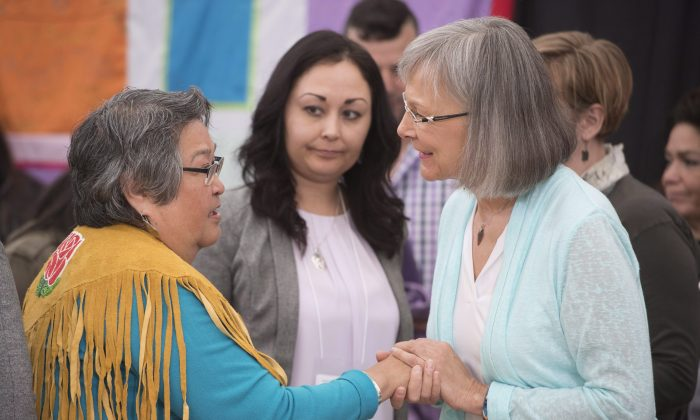 Chief Commissioner Marion Buller greets Frances Neumann after she spoke at the National Inquiry into Missing and Murdered Indigenous Women and Girls in Whitehorse, Yukon, on May 30, 2017. (The Canadian Press/Jonathan Hayward)