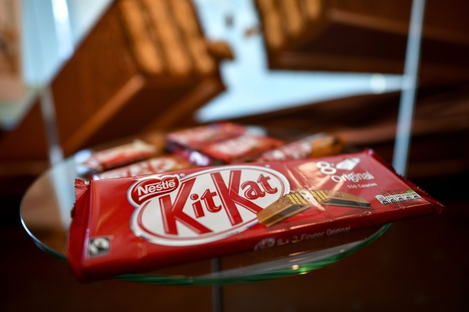 """A pack of chocolate-covered wafer biscuit bar KitKat brand is displayed in the showroom of Swiss food giant's Nestle on October 20, 2016 in Vevey. Sales of Swiss food giant Nestle rose slightly in the first 9 months of 2016, in a """"more sluggish"""" environment, which led the group to strongly revise downwards its expectations for the full 2016 year. According to a statement released October 20, the group recorded a one-percent increase in sales over the first nine months of 2016 to 65,500,000,000 francs (60 billion euros). / AFP / FABRICE COFFRINI        (Photo credit should read FABRICE COFFRINI/AFP/Getty Images)"""