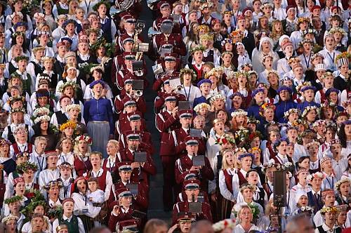 Every five years up to 40,000 costumed singers and dancers gather in Latvia to sing both ancient folk songs and contemporary compositions.  (State Agency of Intangible Cultural Republic of Latvia)