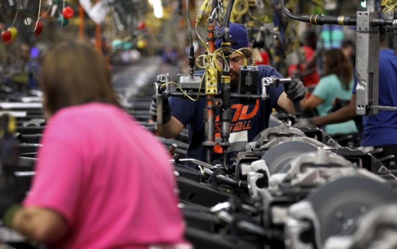 Jacob Bailey conducts assembly on an SUV chassis at the General Motors Assembly Plant in Arlington, Texas on June 9, 2015. (REUTERS/Mike Stone)
