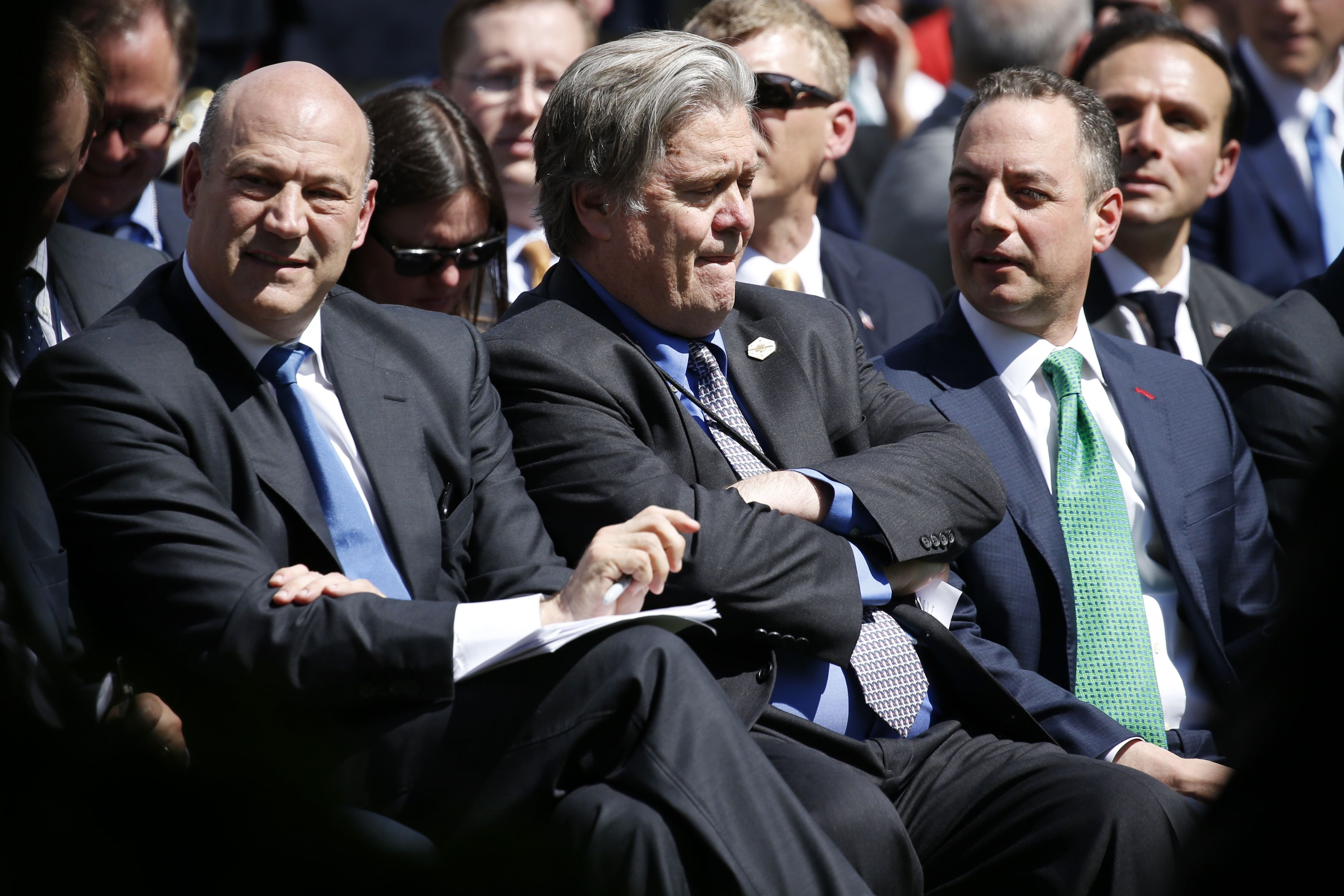 Director of the White House National Economic Council Gary Cohn, White House Chief Strategist Stephen Bannon and Chief of Staff Reince Priebus (L-R) wait in the Rose Garden prior to President Donald Trump announcing his decision on whether the U.S. will remain in the Paris Climate Agreement, at the White House in Washington on June 1, 2017. (REUTERS/Joshua Roberts)