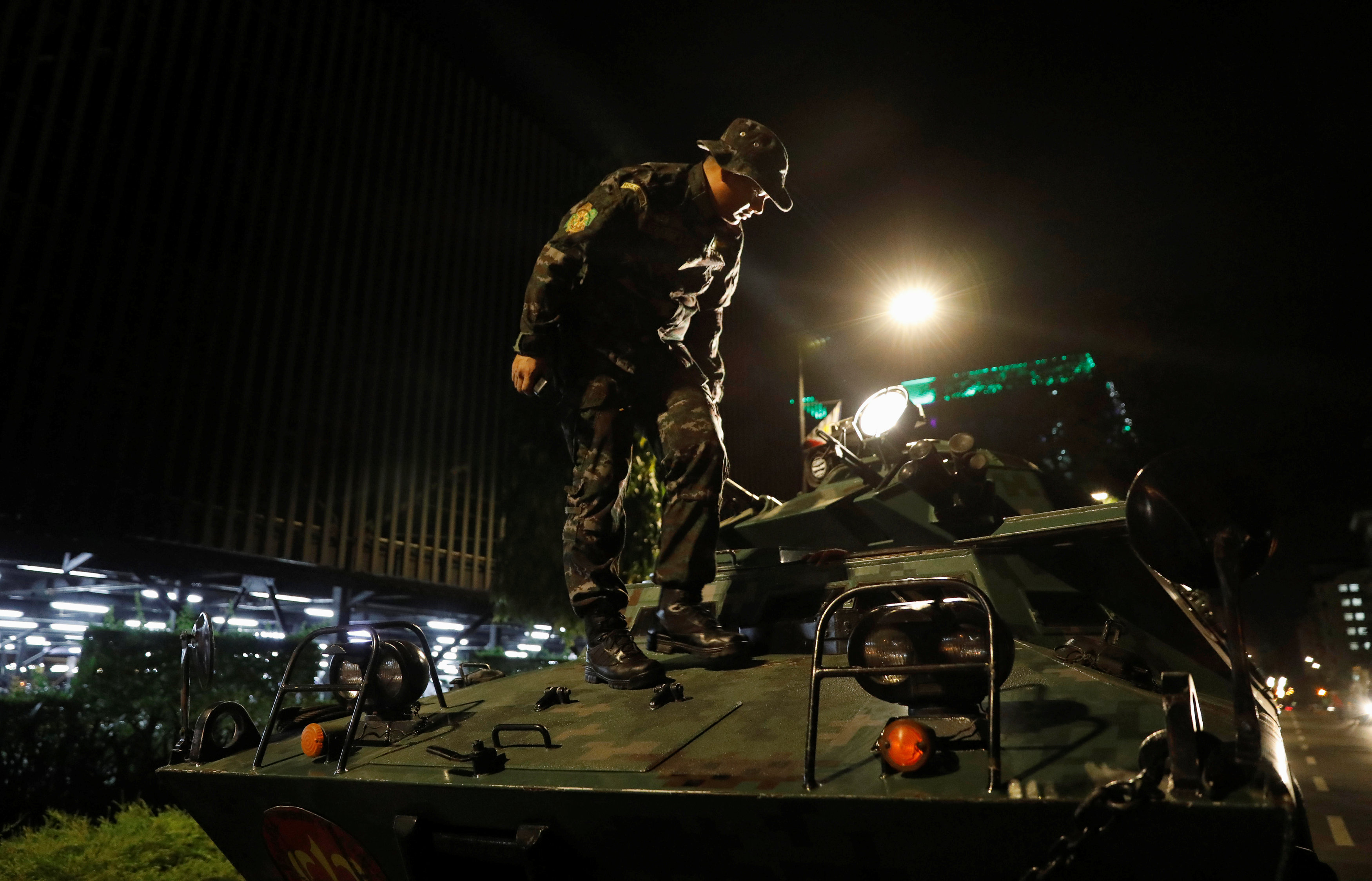 A policeman alights from an armoured fighting vehicle (AFV) near the Resorts World Manila after gunshots and explosions were heard in Pasay City, Metro Manila, Philippines on June 2, 2017. (REUTERS/Erik De Castro)