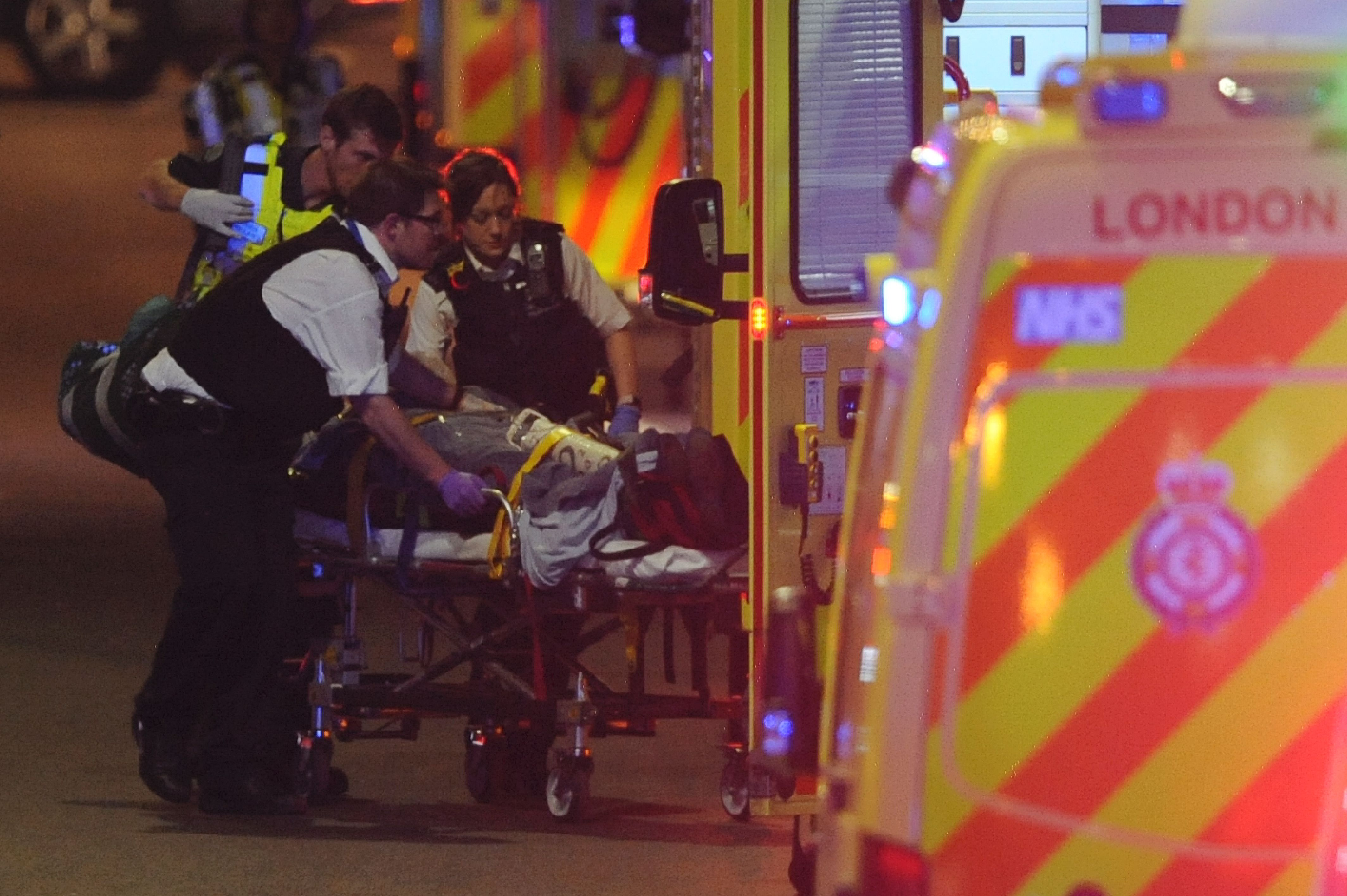 Police officers and members of the emergency services attend to a person injured in a terror attack on London Bridge in central London on June 3, 2017. (Daniel Sorabji/AFP/Getty Images)