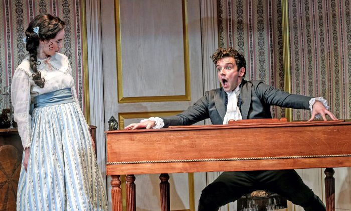 """The mayor's daughter (Talene Monahon) and Ivan Alexandreyevich Hlestekov (Michael Urie), who is assumed to be government official sent to spy on the town, in """"The Government Inspector."""" (Carol Rosegg)"""