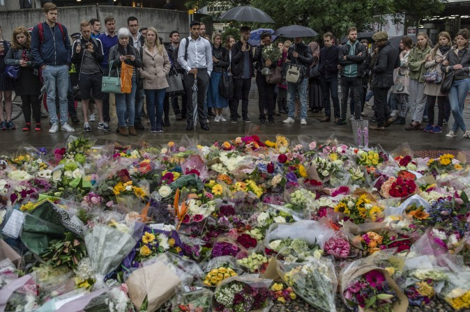 Members of the public gather near a makeshift memorial on the South side of London Bridge, in tribute to the victims of the June 3 attacks, in London on on June 5. (Dan Kitwood/Getty Images)