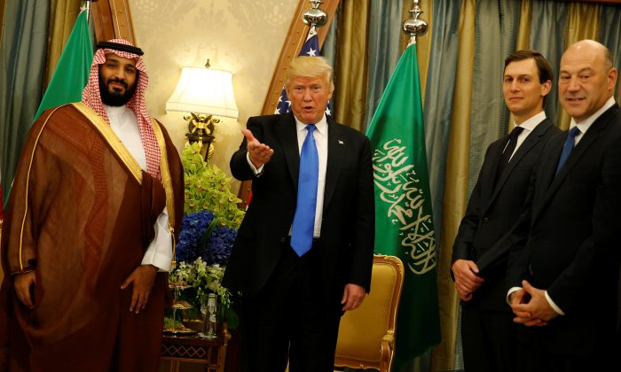 President Trump, flanked by White House senior advisor Jared Kushner and chief economic advisor Gary Cohn, delivers remarks to reporters after meeting with Saudi Arabia's Deputy Crown Prince and Minister of Defense Mohammed bin Salman (L) at the Ritz Carlton Hotel in Riyadh. (REUTERS/Jonathan Ernst)