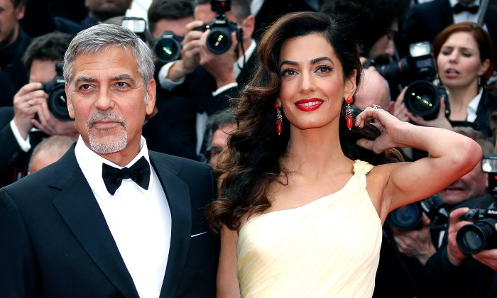 """Cast member George Clooney and his wife Amal arrive for the screening of the film """"Money Monster"""" out of competition during the 69th Cannes Film Festival in Cannes, France on May 12, 2016.(REUTERS/Eric Gaillard)"""