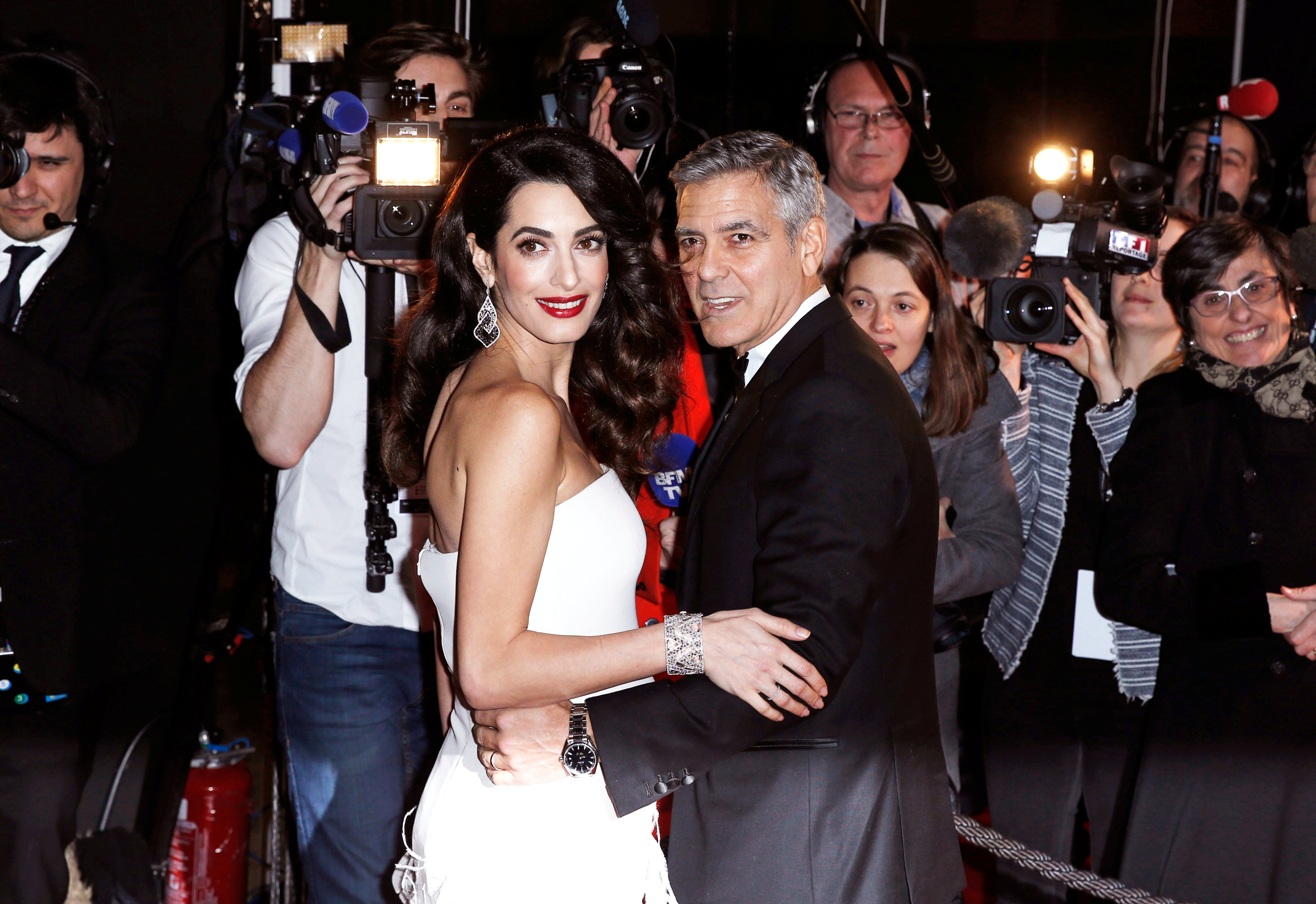 Actor George Clooney and his wife Amal arrive at the 42nd Cesar Awards ceremony in Paris, France on Feb. 24, 2017. (REUTERS/Gonzalo Fuentes)