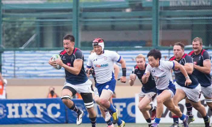 Hong Kong's Kyle Sllivan outsprints the Korean defence during Hong Kong's 39-3 win against South Korea  in the last of the 2017 Asia Rugby Championship matches at Hong Kong Football Club on Saturday June  3. (Dan Marchant)