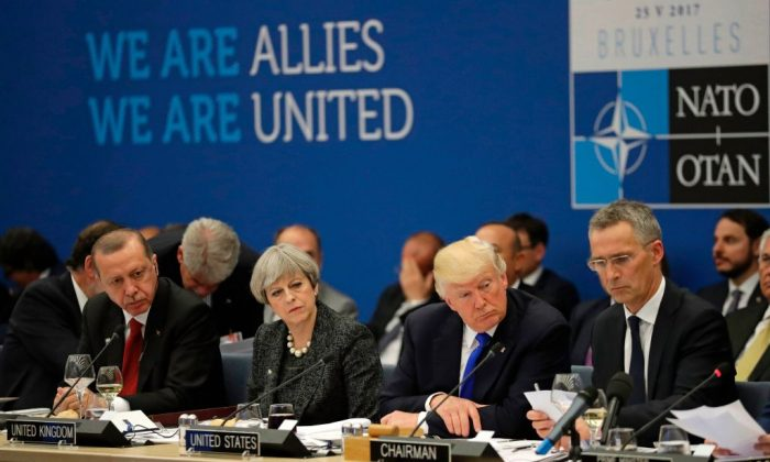 (L-R) Turkey's President Recep Tayyip Erdogan, Britain's Prime Minister Theresa May, President Donald Trump during a working dinner meeting at the NATO (North Atlantic Treaty Organization) headquarters in Brussels on May 25, 2017 during a NATO summit.  (MATT DUNHAM/AFP/Getty Images)
