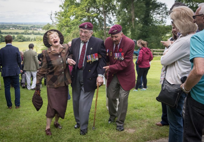 Paratrooper Gordon Newton (C) who was in the 9th battalion and Geoff Paterson 9th Para (R) share a joke as they commemorate the 73rd anniversary of the D-Day landings near Caen, France, on June 5, 2017. D-Day landings, which is commemorated on June 6, saw 156,000 troops from the allied countries, including the United Kingdom and the United States, join forces to launch an audacious attack on the beaches of Normandy, and these assaults are credited with aiding the eventual defeat of Nazi Germany. (Matt Cardy/Getty Images)