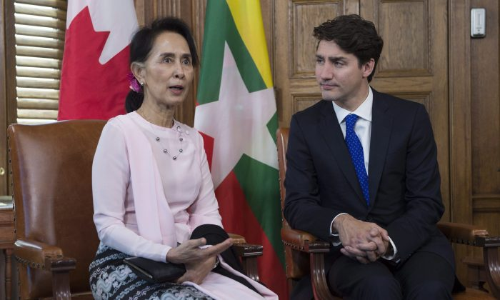 Myanmar's State Counsellor Aung San Suu Kyi meets with Prime Minister Justin Trudeau in his office on Parliament Hill in Ottawa on June 7, 2017. (THE CANADIAN PRESS/Adrian Wyld)