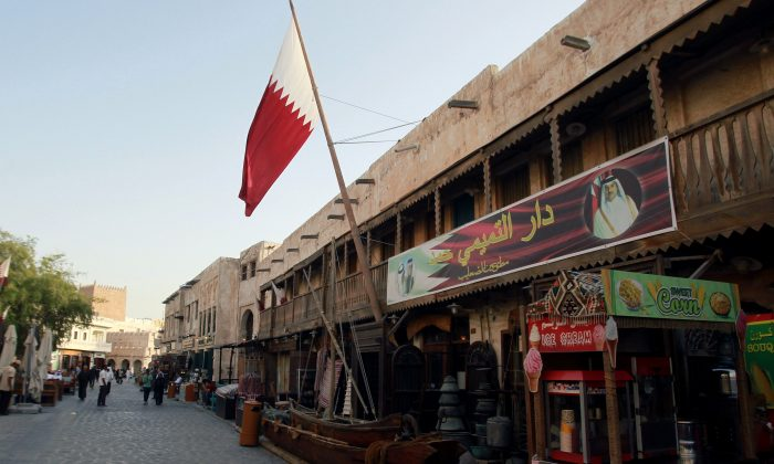 A shop with a picture of Qatar's Emir Sheikh Tamim Bin Hamad Al-Thani is seen in Doha, Qatar onJune 6, 2017. (REUTERS/Naseem Zeitoon)