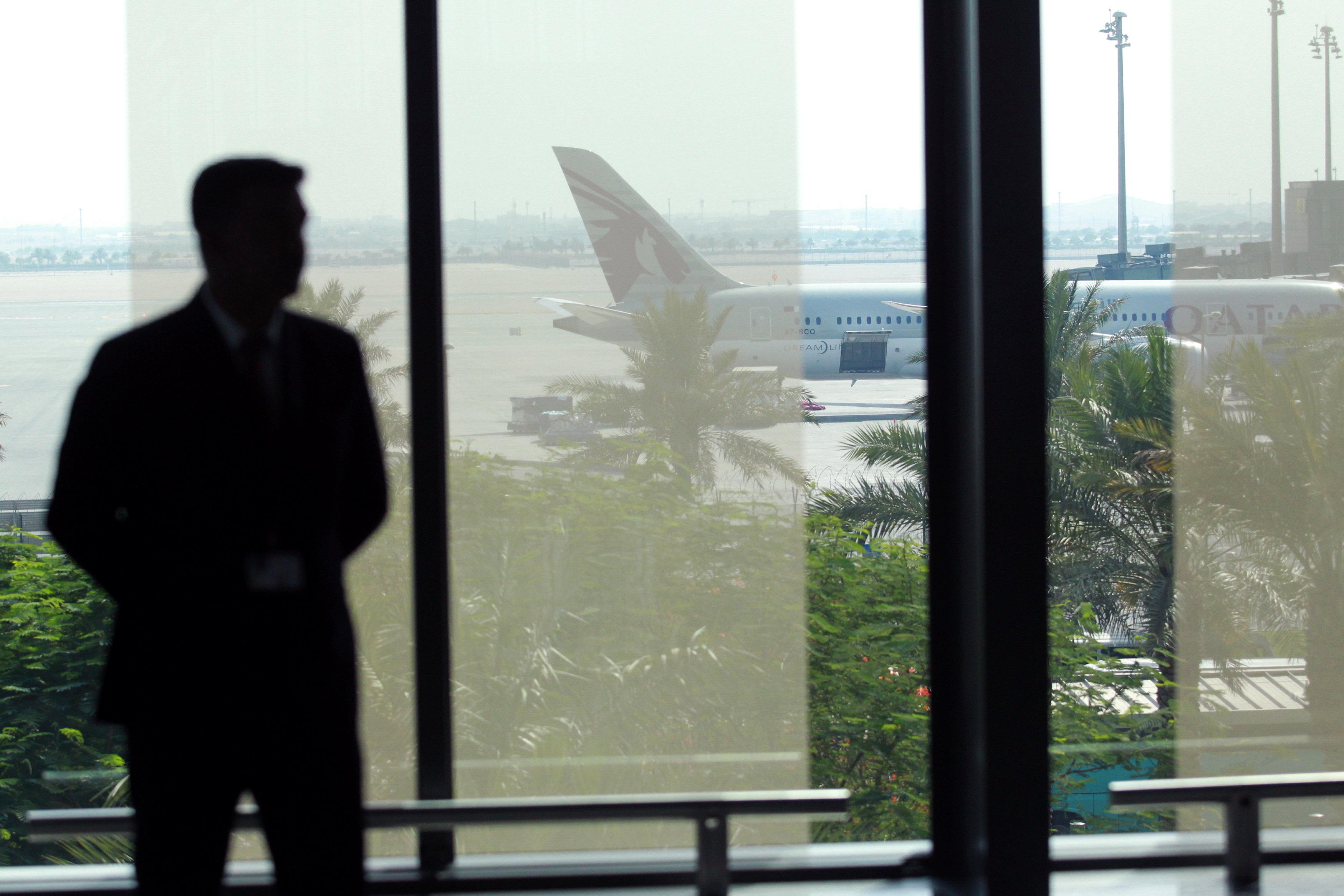 A staff memeber stands at Hamad International Airport in Doha, Qatar on June 7, 2017. (REUTERS/Naseem Zeitoon)