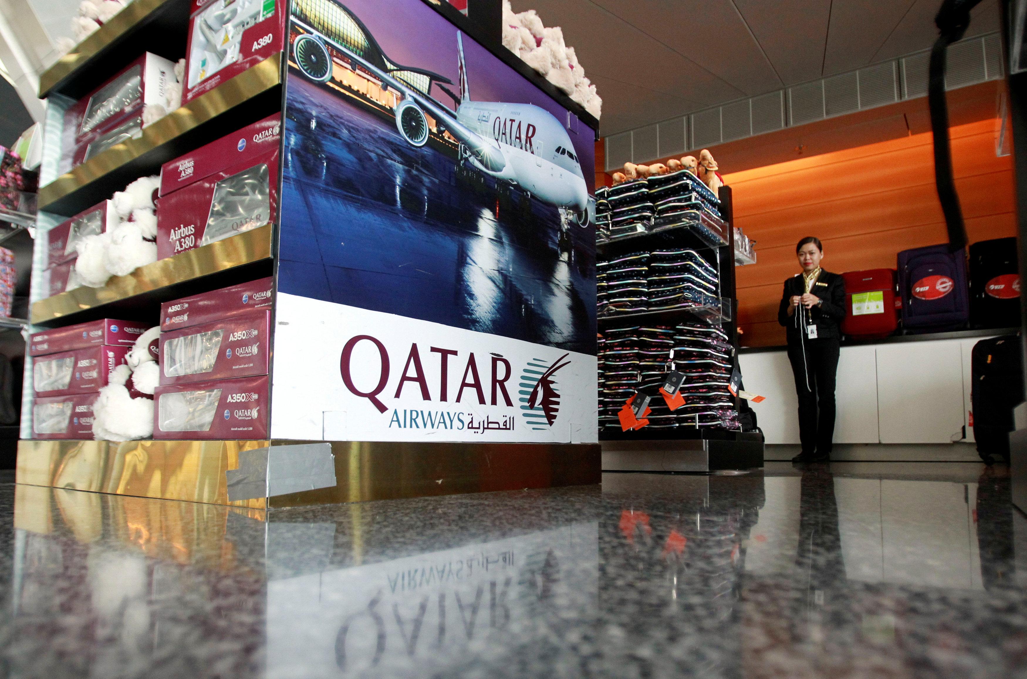 A sign of Qatar Airways is seen at Hamad International Airport in Doha, Qatar on June 7, 2017. (REUTERS/Naseem Zeitoon)