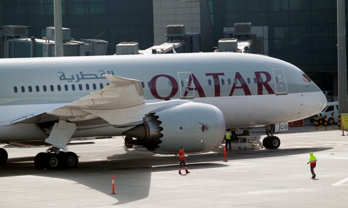 A Qatar Airways aircraft is seen at Hamad International Airport in Doha, Qatar on June 7, 2017. (REUTERS/Naseem Zeitoon)