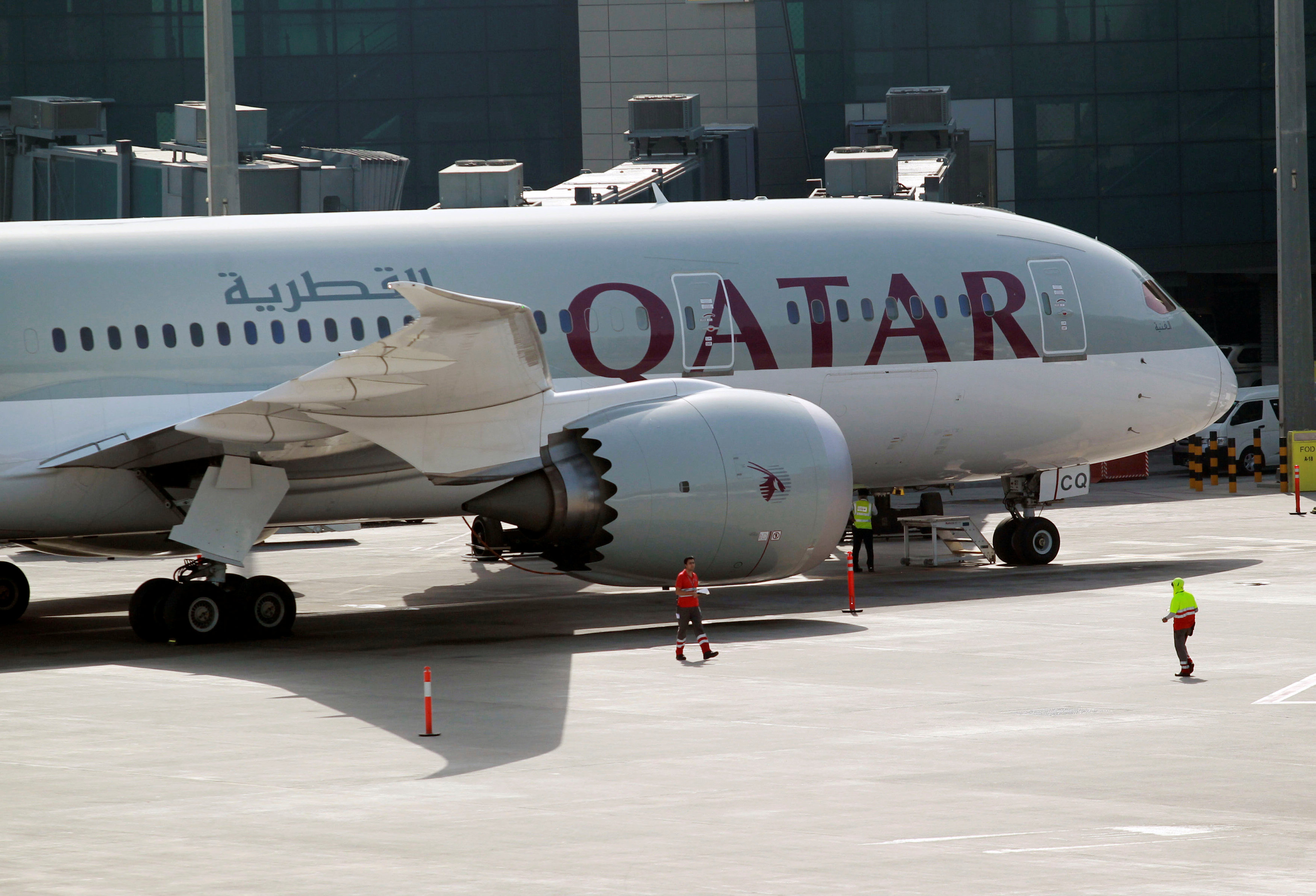 A Qatar Airways aircraft is seen at Hamad International Airport in Doha, Qatar on June 7, 2017. (REUTERS/Naseem Zeitoon)