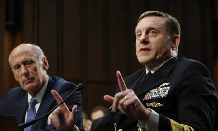 Director of National Intelligence Daniel Coats (L) listens as National Security Agency Director Michael Rogers (R) testifies before a Senate Intelligence Committee hearing on Capitol Hill in Washington on June 7, 2017. (REUTERS/Kevin Lamarque)