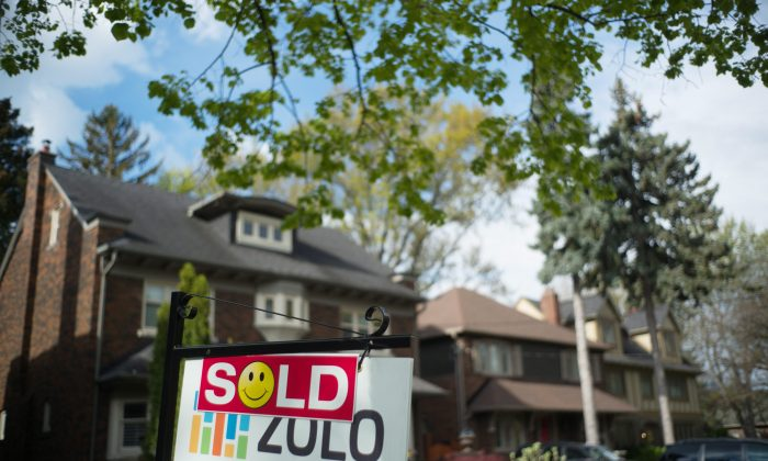 A sold sign in front of a west-end Toronto home on May 14, 2017. Sales and prices are down while listings are way up in the latest report from the Toronto Real Estate Board. (The Canadian Press/Graeme Roy)