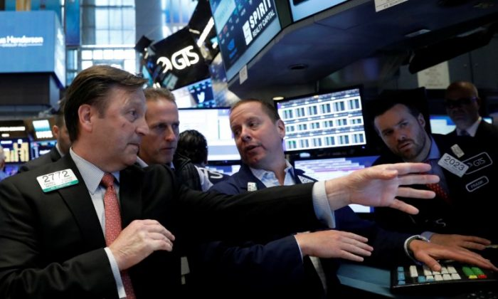 Traders work on the floor of the New York Stock Exchange (NYSE) in New York on June 2, 2017. (REUTERS/Brendan McDermid)