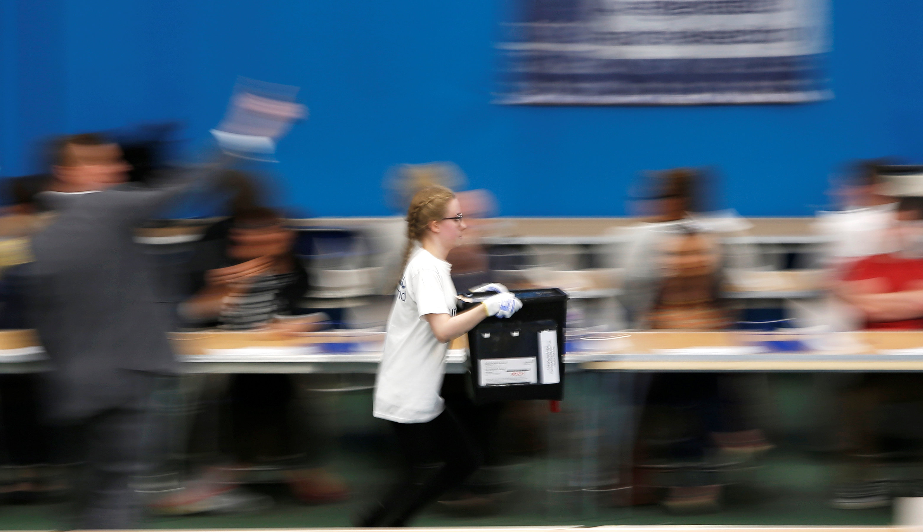 A ballot box is rushed into the counting centre for Britain's general election in Sunderland on June 8, 2017. (REUTERS/Ed Sykes)