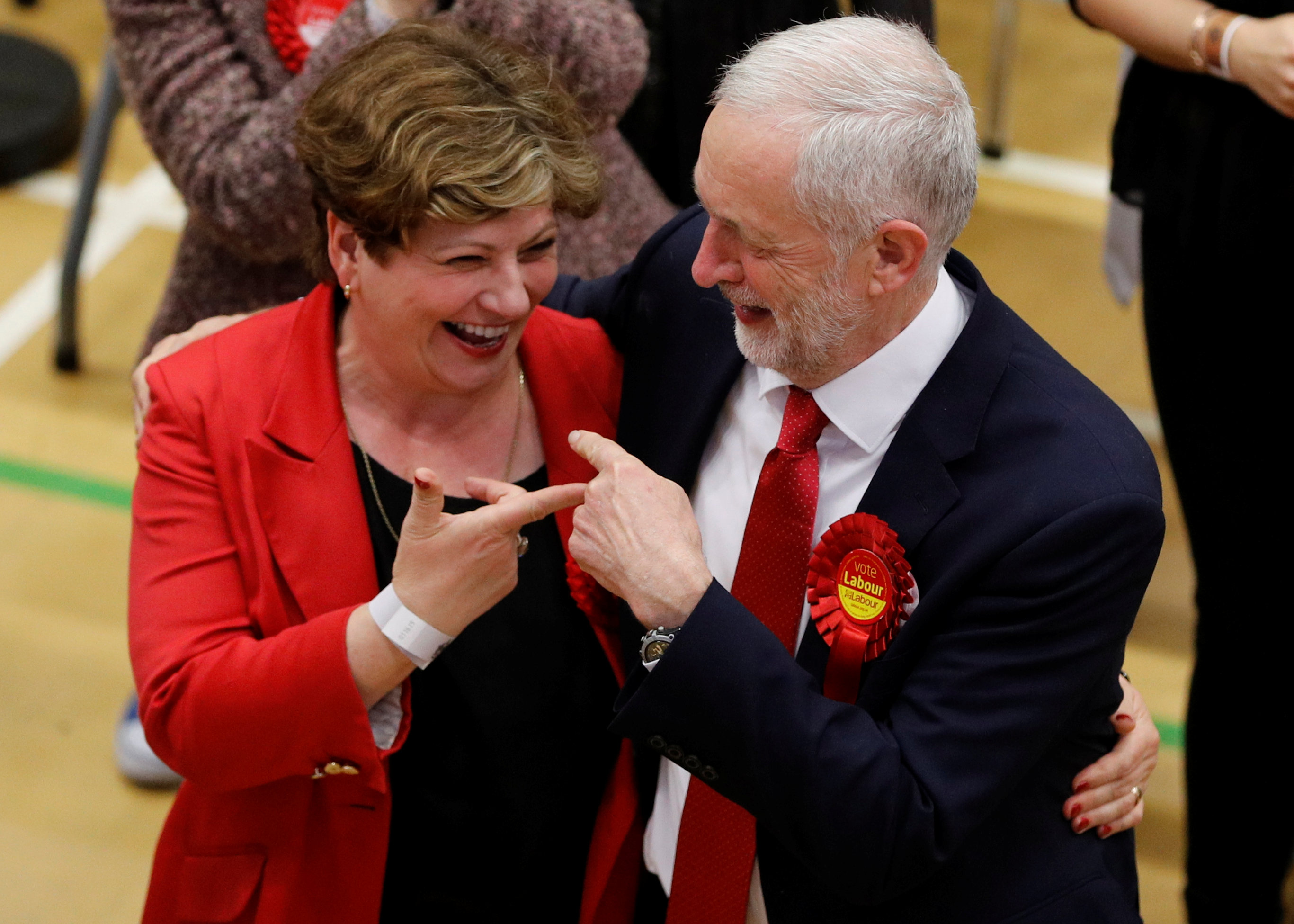 Jeremy Corbyn, leader of Britain's opposition Labour Party, and Labour Party candidate Emily Thornberry gesture at a counting centre for Britain's general election in London on June 9, 2017. (REUTERS/Darren Staples)