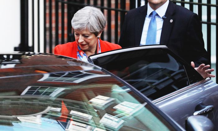 Britain's Prime Minister Theresa May leaves the Conservative Party's Headquarters after Britain's election in London, on June 9, 2017. (REUTERS/Peter Nicholls)