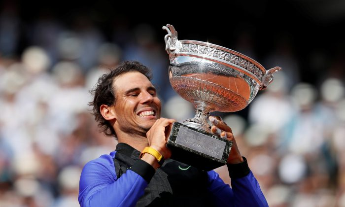 Spain's Rafael Nadal celebrates with the trophy after winning the final against Switzerland's Stan Wawrinka Paris, France on June 11, 2017. (Reuters/Christian Hartmann)