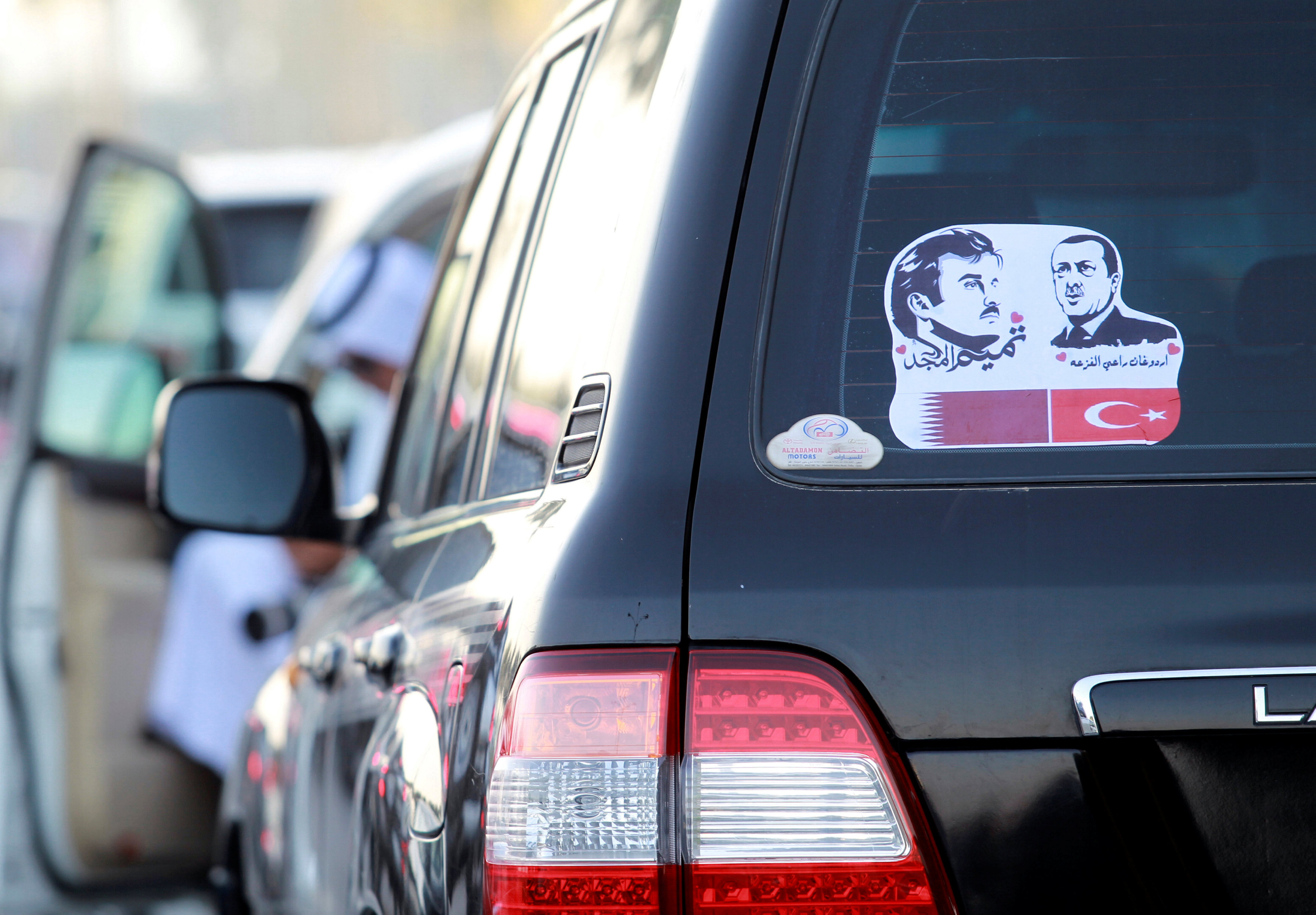 The pictures of Qatar's Emir Sheikh Tamim Bin Hamad Al-Thani (L) and Turkish President Tayyip Erdogan are seen on a car during a demonstration in support of him in Doha, Qatar on June 11, 2017. (REUTERS/Naseem Zeitoon)