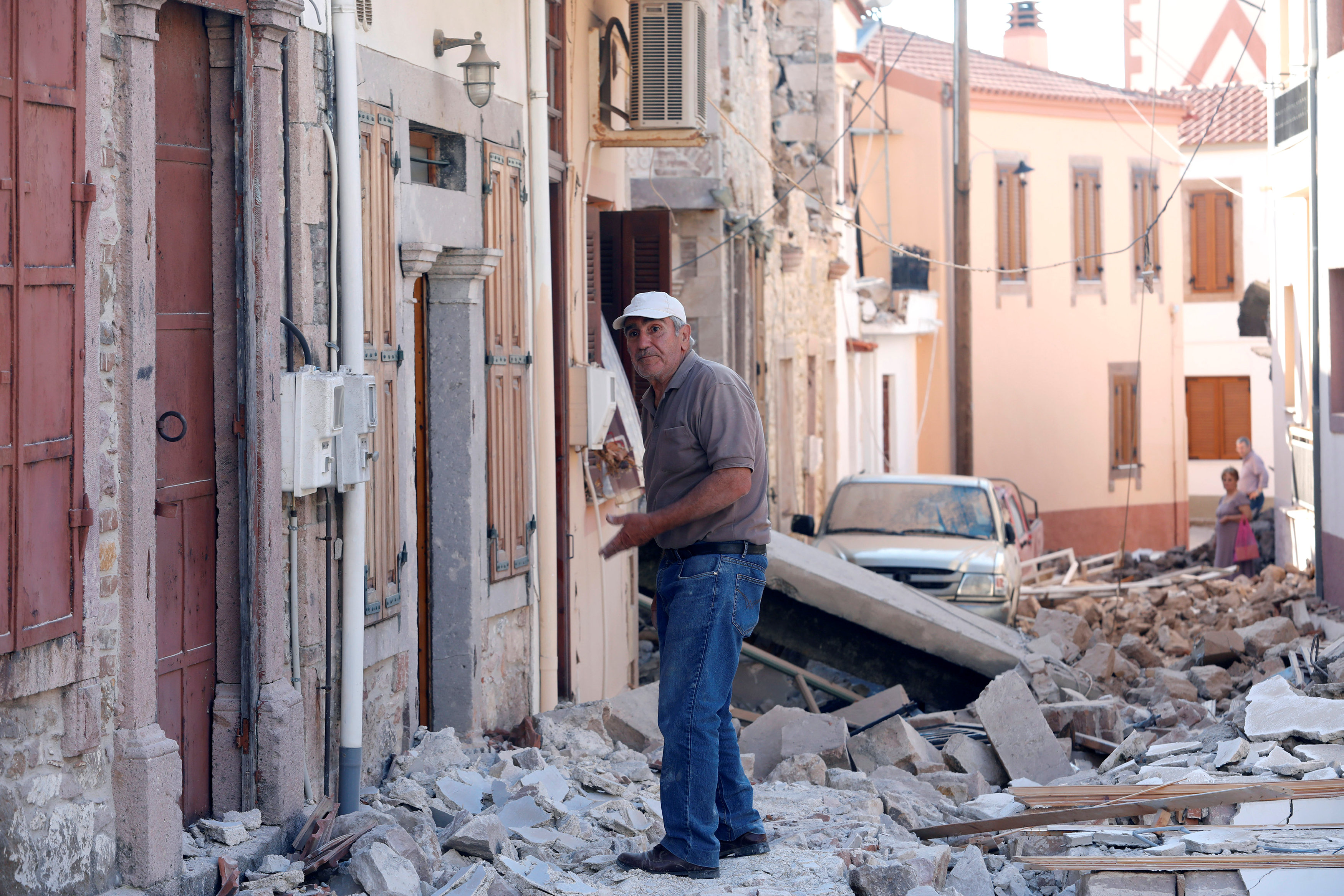A man stands among damaged buildings at the village of Vrissa on the Greek island of Lesbos, Greece, after a strong earthquake shook the eastern Aegean on June 12, 2017. (REUTERS/Giorgos Moutafis)