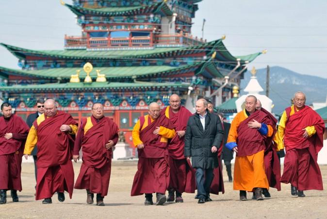 Russian President Vladimir Putin (3rdR) walks with Buddhist monks as he visits Ivolginsky Datsan (monastery) in the village of Verkhnyaya Ivolga, Republic of Buryatia on April 11, 2013.  (ALEKSEY NIKOLSKYI/AFP/Getty Images)