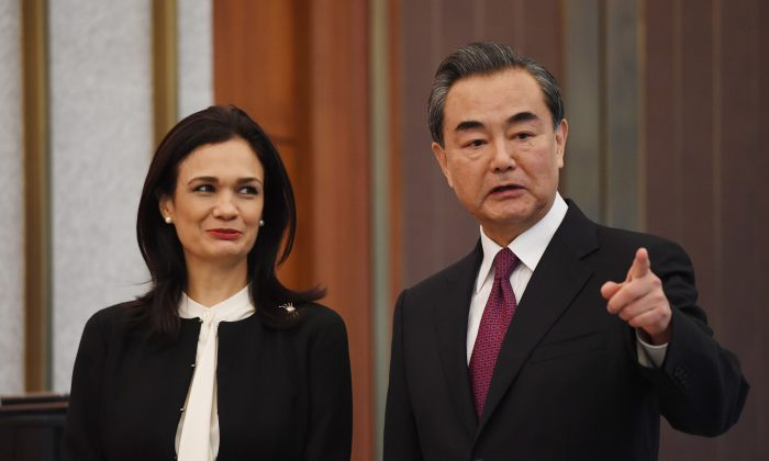 Panama's Vice President and Foreign Minister Isabel de Saint Malo (L) and Chinese Foreign Minister Wang Yi chat during a ceremony on establishing diplomatic relations on June 13, 2017 in Beijing, China (Greg Baker - Pool/Getty Images)
