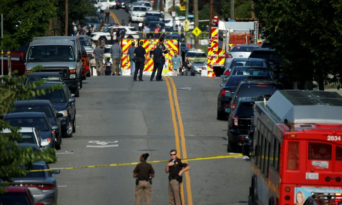 Police man a shooting scene after a gunman opened fire on Republican members of Congress during a baseball practice near Washington in Alexandria, Virginia, on  June 14, 2017. (Reuters/Joshua Roberts)