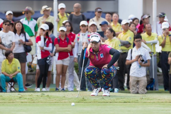 Hong Kong Open winner Supamas Sangchan of Thailand lines up a put on the 18th green before claiming the EFG Hong Kong Ladies Open title at Fanling Golf Club, on Sunday June 11, 2017. (Dan Marchant)