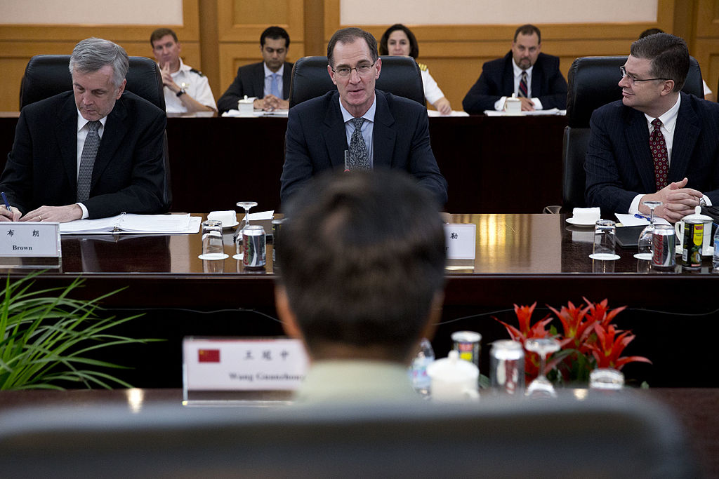 James Miller, center, U.S. Under Secretary of Defense for Policy, during a meeting with Maj. Gen. Wang Guanzhong, front, deputy chief of general staff of the People's Liberation Army, at Chinese Defense Ministry's Bayi Building in Beijing, China on Sept. 9, 2013. (Alexander F. Yuan-Pool/Getty Images)