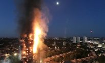 UK Prime Minister Rushed From Area of London Fire After Protests