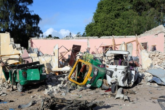 Damaged vehicles are seen at the scene of an attack outside a hotel and an adjacent restaurant in Mogadishu, Somalia June 15, 2017. (Reuters/Stringer)