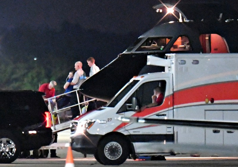 A person believed to be Otto Warmbier is transferred from a medical transport airplane to an awaiting ambulance at Lunken Airport in Cincinnati, Ohio. (REUTERS/Bryan Woolston)
